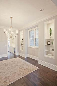 warm grey wall paint with white trim pld homes via houzz in 2019 home home builders custom