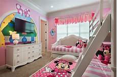 minnie mouse would definitely approve of this pink bedroom