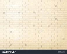 brick wall tile texture background painted in yellow cream color tone tiled brick wall in light
