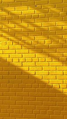yellow brick wall with beautiful lighting wallpaper gelber hintergrund hintergrundbilder