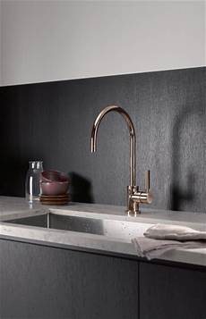 dornbracht kitchen faucets dornbracht s cyprum line of faucets made from 18 carat gold and copper are in keeping with the