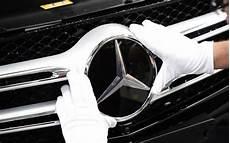 daimler profit halves at mercedes owner as diesel