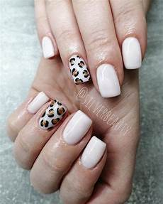 cute short nails design with an accent leopard print nail