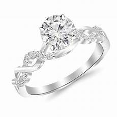 2 carat classic prong diamond engagement ring with a 1