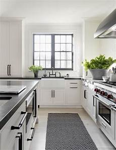 really like the undermount farmhouse sink like the matte black hardware and the black windows