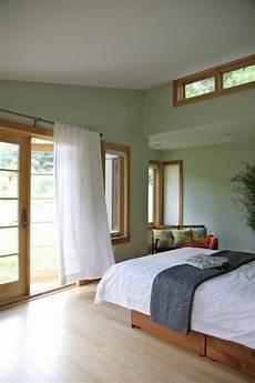 green with oak trim natural trim oak trim bedroom