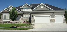 gray stucco with rock accent and white trim stucco