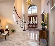 grand foyer grand foyer staircase chandelier marble floor showcase