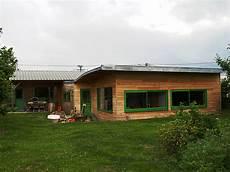 extension d une maison de plain pied aux toitures courbes