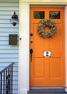 best orange paint color for front door can i paint an orange colored house light green the expert