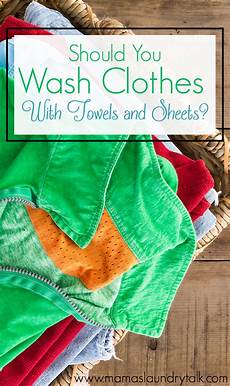 should you wash clothes with towels and sheets s laundry talk