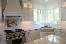 lovely white classic kitchen with unique corner apron sink layout dishwasher to the left of