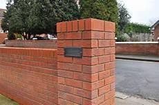 installing external l brick wall s car
