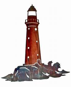 lighthouse on the rocks laser cut metal wall art sil