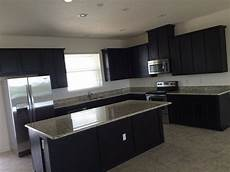 need help paint color that compliments our espresso cabinets