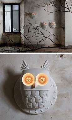 designer matteo ugolini has created ti vedo an owl shaped table l and wall l for italian