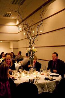 tall branch centerpieces with hanging candles weddingbee