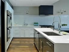 sleek white kitchen with glass tile backsplash hgtv