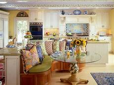 yellow country kitchen with colorful banquette area hgtv