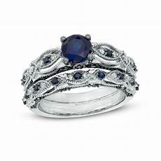 6 0mm lab created blue sapphire and 1 10 ct t w diamond vintage style bridal in 10k white