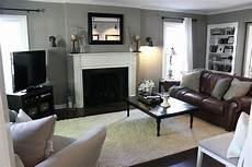 elegant grey color ideas for living room with brick fireplace and brown furniture brown