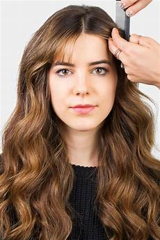 How To Style Middle Part Bangs With Hair how to style bangs 5 hairstyles to keep your bangs out