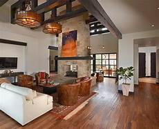 a grand lakeside home with rustic grand and rustic living room design with exposed beams and