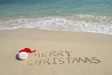 merry christmas written tropical white sand with snowman stock image image of date