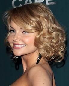 2014 medium wavy curly hairstyle with side swept bangs for women pretty designs