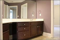 Bathroom Ideas Brown Cabinets by Brown Cabinets In A Purple Bathroom New Home Design