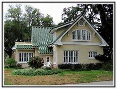 yellow house with green metal roof house paint exterior yellow houses cottage exterior colors