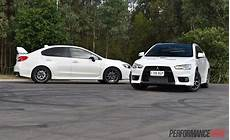 Subaru Or Evo by 2016 Mitsubishi Lancer Evolution Vs Subaru Wrx Sti