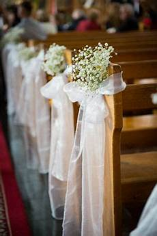 babys breath decorated church pews brides of adelaide