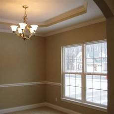 khaki interior paint color dining room painted with relaxed khaki sw 6149 yellow paint colors warm paint colors paint