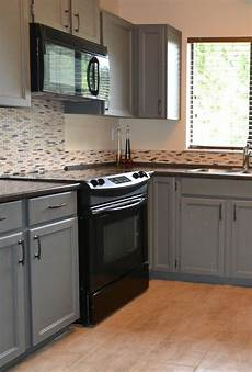 how to decorate a kitchen with black appliances and benjamin chelsea gray painted oak