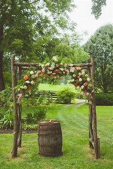 wooden wedding arch with coral flowers wedding decor