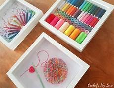 crocheting inspired string art craft room wall art