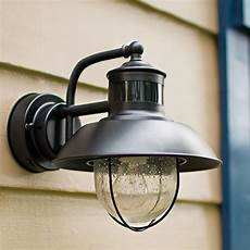 motion activated outdoor wall lights are practical energy efficient and add an aesthetic touch