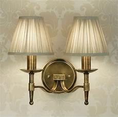 brass double wall light