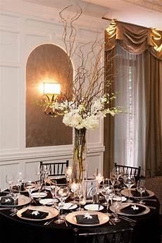 their tall centerpieces were curly willow branches white