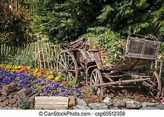 Old Coach Used As Decoration In A Garden