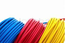 electric wires of yellow and dark blue colour are winded in rings colourbox