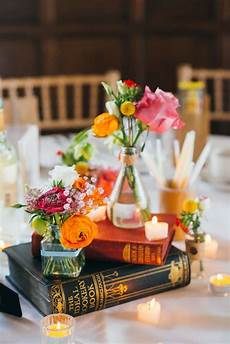 pretty vintage books repurposed as colorful centerpieces everything books book wedding