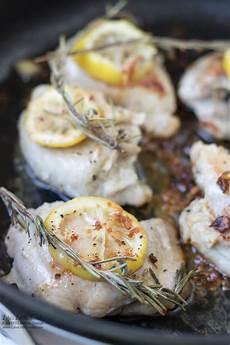 lemon rosemary skillet chicken thighs rosemary sprigs
