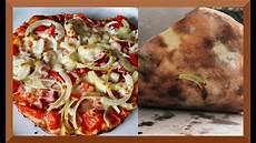 pizza vom grill mit dem pizzastein