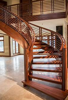 modern stair design with sapele and inlayed stainless