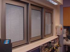 between glass blinds doors windows with blinds between