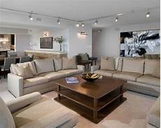 comfortable modern striped sofa set and track lighting living room mixed with wall art feats