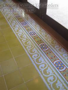 like the tile border and the floor powder cement tile borders pull it all together cement style