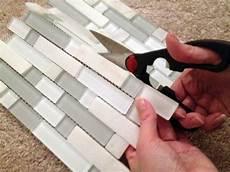 Tiling A Backsplash With Tile Sheets diy kitchen backsplash part 4 installing backsplash tiles